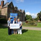 Presenting €5,957 to Make a Wish: Sabine Rosler of Wells House, Rachel Tutty of Make a Wish Ireland and Cllr Mary Farrell