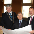 Minister Brendan Howlin (centre) with Cllr Paddy Kavanagh and Wexford County Council CEO Tom Enright at the signing of contracts at the Athenaeum on Monday