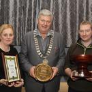 Cllr. Paddy Kavanagh presents best shop front award to owners of Stamps pub, Karl and Julie Forster