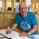 Frank O'Connor from Ross Road, Enniscorthy, signing the book of condolences