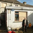 Paddy Kelly from Moran Park in Enniscorthy assessing the damage caused to his home by a lightning bolt