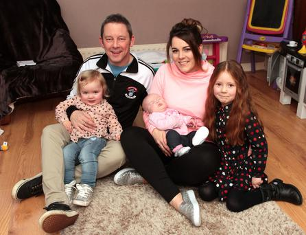 Kerri Stedman at home with her husband George and children Poppy, Emily and Lucy