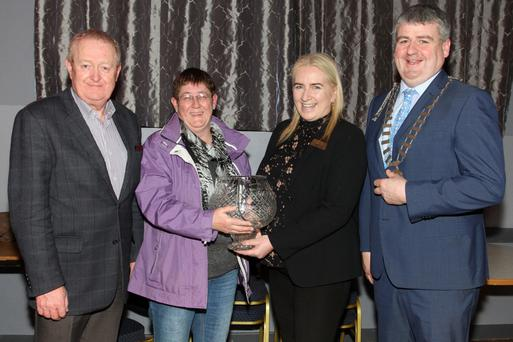 The Tidy Towns Community Award winner was presented at the IFA Centre. Pictured are: Bill Murphy, chairman, Enniscorthy Tidy Towns; Terry Cullen, The Barleyfield, who accepted the award on behalf of her husband Thomas; Rosaleen Casey, Pettitt's, who sponsored the award and Cllr oliver Walsh, chairman Enniscorthy Municipal District Council