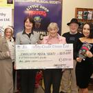 Bernie Morrissey of Enniscorthy Credit Union presents Liz Armstrong of Enniscorthy Musical Society with a cheque for €1,500 at the recent launch of the society's upcoming production of Little Shop of Horrors. Also pictured were cast members Eryn Buckley, Corah Dobbs, Mary Dobbs, Lorcan Dunne and Niamh Bolger