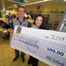 Corrine Doherty, Aldi's Bunclody 'Charity Champion', presents a cheque for €500 to Michael O'Neill of Touched by Suicide