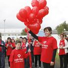 Dylon and Fiona Devereux releasing balloons at the start of the Ger Devereux Memorial walk and run