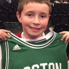Left: a delighted young Eamonn Furlong with the shirt Ed Sheeran wore onstage for the encore in Boston (right)