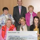 Presentation of a cheque for €20,000 to St Anthony's Unit, County Wexford Community Workshop, Enniscorthy in Kilcannon Garden Centre. Back row: Breda Power, Trevor Jacob, CEO, CWCW; Carmel Consadine, Monique Crean, Maeve Doyle, Walter Kelly and Jacqui Murphy. Front: Lizzie Lambert, Bernie Doyle, Tara Somers, team leader, St Anthony's Unit; Breda Coffey, Nellie Doyle and Joan Murphy