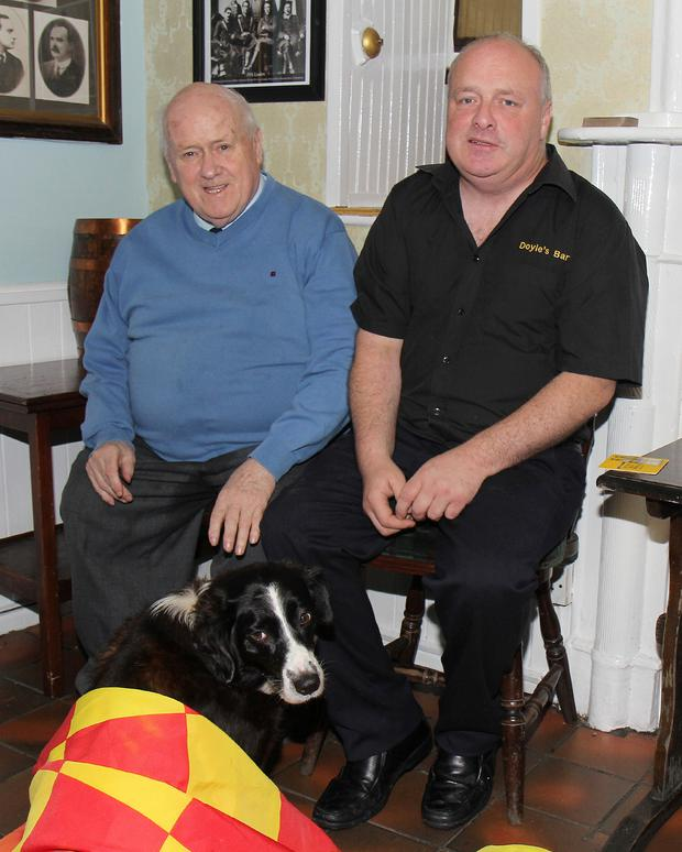 Proprietor John Doyle with his son Joe and his faithful companion 'Lady'