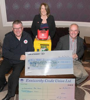 Presentation of cheques to Paddy Redmond (Enniscorthy Red Cross) and Bridget Sinnott (Irish Heart Foundation) by Michael Devereux, proceeds of Ger Devereux Memorial Walk