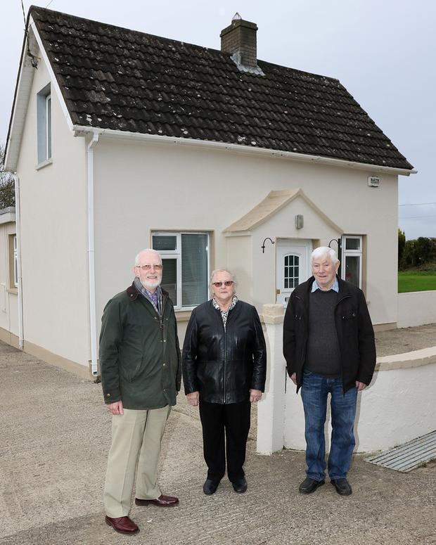 Terry Dignan (grandson), Pat Mulvey (who's father was in Croke Park on the day) and Alec Ryan (nephew) outside the ancestral home of Tom Ryan at Ballydonfin, Glenbrien