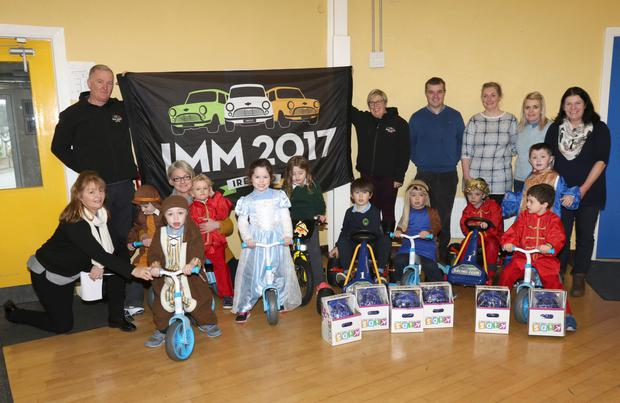 Martin Murphy, a member of The Irish Mini Owners Club, donated bikes and go-karts to the Autistic Unit of St. Senan's Primary School. He is pictured with children from the unit, SNA's and deputy principal Seamus Kavanagh