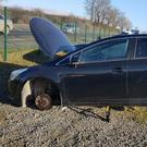 The car that was completely stripped of parts at M O'Connor Car Sales at Scarawalsh