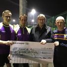 Brian Murphy, Brian Maher, Ian Booth (St. Vincent de Paul) and Jessie O Connor at the cheque presentation from the Enniscorthy Beer Mile