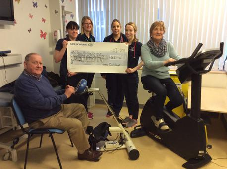 Organisers Josie Gahan and Willie Walsh present the proceeds from The Harrow Cycle to staff at Temple Street Children's Hospital