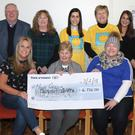 Rachel McHugh and Triona Doyle, on behalf the group, present the cheque to Una Doherty, chairperson, Hope Centre