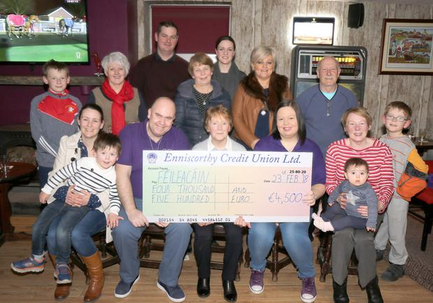 Margaret Walker, representing the local group, presenting a cheque for €4,500 to Féileacáin, represented by Trevor and Krystle Hunt, proceeds of a coffee morning held in The Presentation Centre. The presentation was made in Dawson's Lounge