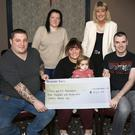 At the Cosmic Rebel Con presentation of a cheque for €930 to the Jack & Jill Foundation in the Riverside Park Hotel were back row: Linda Mahon and Joanne Doyle, children's nurse Jack & Jill Foundation; front row: Brian Thomas, Becky and Bella Rose Furlong and Ed Doyle