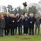 Minister Paul Kehoe throws the sod at the sod turning for Ballindaggin Community Park