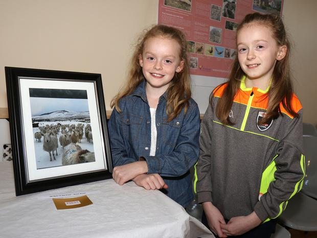 Roisin Dwyer, who won first prize at the Kiltealy photo exhibition, pictured with her sister Kate