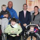 Damien English TD, Minister for Housing and Urban Renewal pictured with the Dempsey-Dobbs-Boyle family, Rita, Will, Lily, Shona Tom,Luke and Patrick and the Sheil family, T.J.,Darren and Julie when he visited the special needs homes at Cuman Tobair, Oylegate