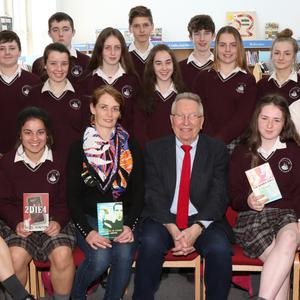 Author Nigel Hinton pictured with class 2 Holly and librarian Éadaoin Quinn when he visited Enniscorthy Vocational College