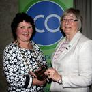Mary D'Arcy, incoming president, receives the chains of office from outgoing president Deirdre Connery