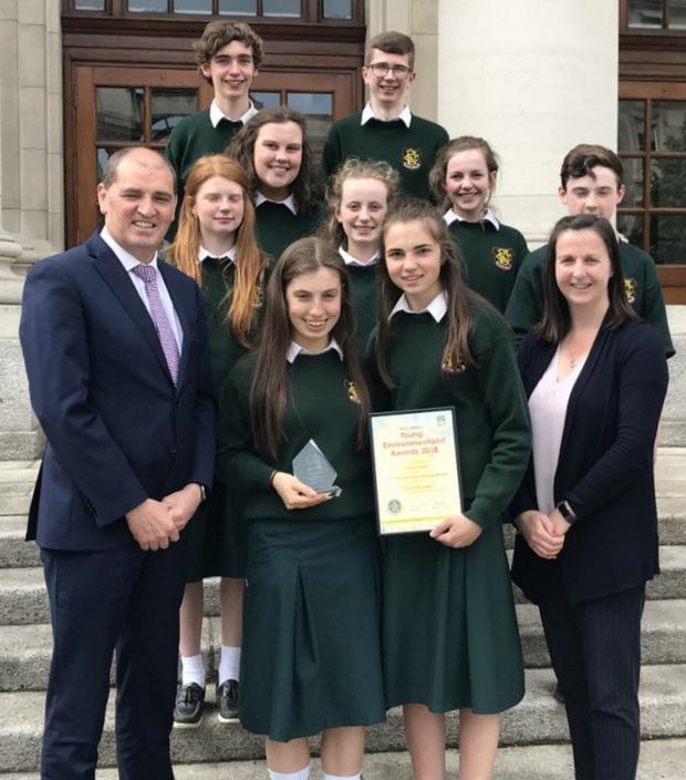 The Eco-UNESCO Environmentalist Award winners from FCJ Bunclody with teacher Ms Catherine Doyle and Minister Paul Kehoe at Leinster House