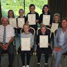 Nora Kavanagh School of Music, presentation of music examination certificates from the London College of Music in the Riverside Park Hotel. Back: Katelyn Redmond, Dervla Peoples, Nicole Cullen, Mary Eliza Murphy and Ellie Kehoe. Front: Seamus Coleman (Enniscorthy CCE), Ele Darulyte, Grace Byrne and Nora Kavanagh (music teacher)