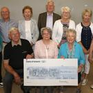 Silvertones Choir, Enniscorthy presentation of cheque for €4000 to Co. Wexford Hospice Homecare, proceeds of Concert in St. Aidan's Cathedral. Back: Sheelagh O'Leary, Colin Pearce, Joan Lunn, Pearse Colbert, Margaret O'Dowd (treasurer), Sally Fleming and Catherine O'Neill. Front: John Maguire (Hospice), Bríd Uí Laoghaire (chairperson) and Mary Bolger (Hospice)