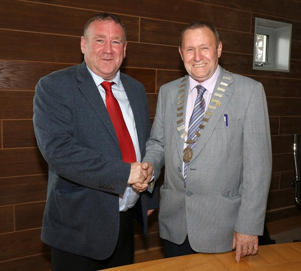 New chairman of Enniscorthy Municipal District, Cllr Willie Kavanagh being congratulated by outgoing chairman, Cllr Keith Doyle