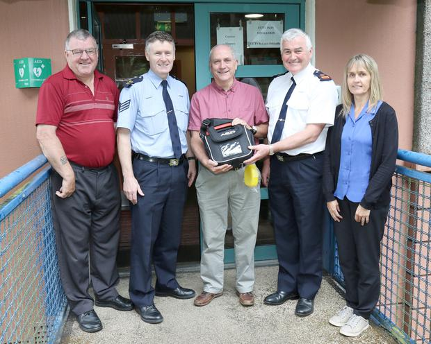 Paddy Redmond, Sgt. Colum Matthews, Michael Devereux, Insp. Gerry McGrath and Karen Tull