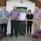 Chairman of Enniscorthy Municipal District, Cllr. Willie Kavanagh, Jim Dunne and Jim Mythen (cutting ribbon) and Eileen and John Dempsey at the Re-opening of Bygone Days Storytelling House, Oulart, following renovations