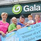 Margaret Frayne, store owner of Frayne's Gala, with staff member Gusia Ruffinyi, holiday winner Peggy Owens, her grandson Finn Kenny, Mary Browne and Gala retail operations executive Lisa Kenny