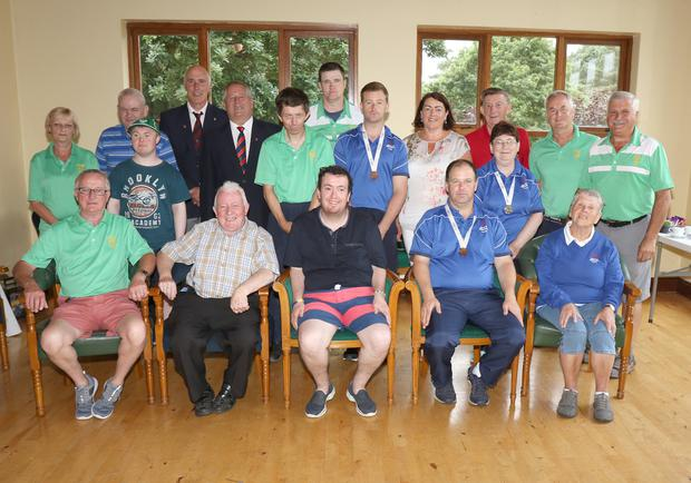 Volunteers from Enniscorthy Golf Club with athletes from Enniscorthy Special Olympics Club