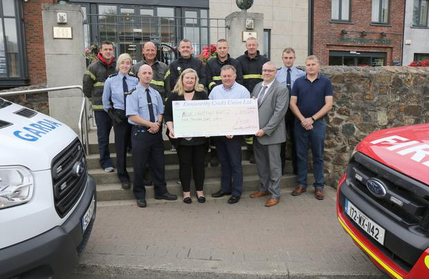Enniscorthy Credit Union present a cheque of €4,000 to the Blue Light Fight Night in aid of St Patrick's Special School