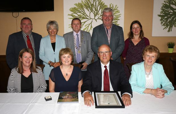 At the civic reception for Mayor Bob Coburn of Muskogee, Oklahoma in Bunclody Golf Club were, back row: Cllr. Keith Doyle, chairman Wexford Co. Council; Gwen Coburn, Cllr. Willie Kavanagh, chairman Enniscorthy Municipal District, Cllr. Paddy Kavanagh and Liz Hore, Area Manager. Front: Joanne Kehoe, Wexford Co. Council, Cllr. Barbara Ann Murphy, Mayor Bob Coburn and Cllr. Kathleen Codd-Nolan