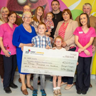 The O'Loughlin family present cheques for €3,610 to Crumlin Children's Hospital and Ronald McDonald House