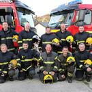 Firefighter Anthony Nolan (centre, back row) with his colleagues at his last night of training, after 28 years with Enniscorthy Fire Service