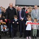 Rylie Kelly cutting the ribbon with Minister Damien English TD at the official opening of the new Ard na hUrrainne housing estate on Monday