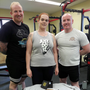 Powerlifters Brendan O'Rourke, Laura O'Shea and David O'Keefe with their haul of medals from the AWPC World Championships in Manchester