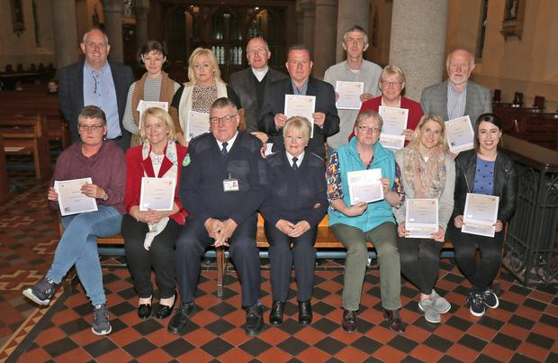St. Aidan's Cathedral group who completed CFR Training, given by Enniscorthy Red Cross members Sally Flynn and Paddy Redmond, were presented with their certs on Thurdsay night