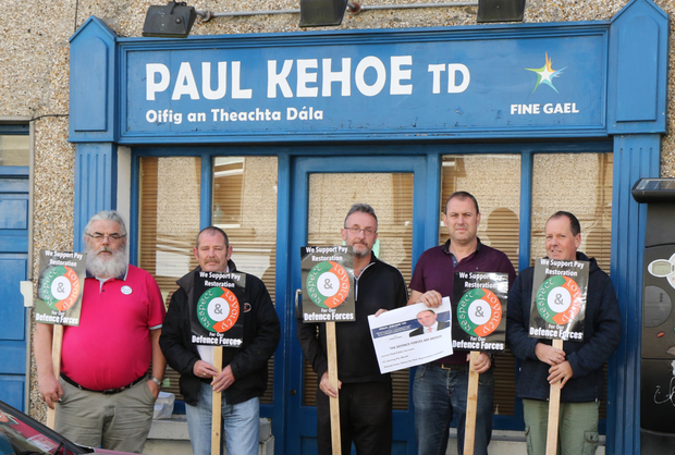Defence Forces members protesting outside Minister Paul Kehoe's office, Enniscorthy on Saturday morning