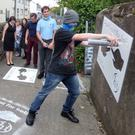 Youngsters from the FDYS in Enniscorthy making use of the new stencils to spread the anti-smoking message