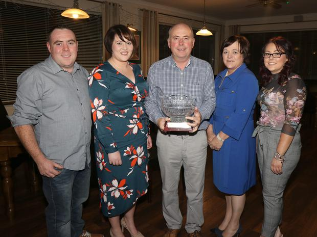 Billy Quirke with his wife Marie, daughters Fiona and Orla and son Niall at his retirement party at Enniscorthy Golf Club
