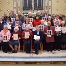 Recipients of pioneer pins and certificates pictured with Bishop Denis Brennan, Fr. Jim Fegan and Fr. Brain Broaders in Kiltealy Church
