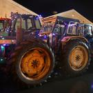 Tractors covered with Christmas lights