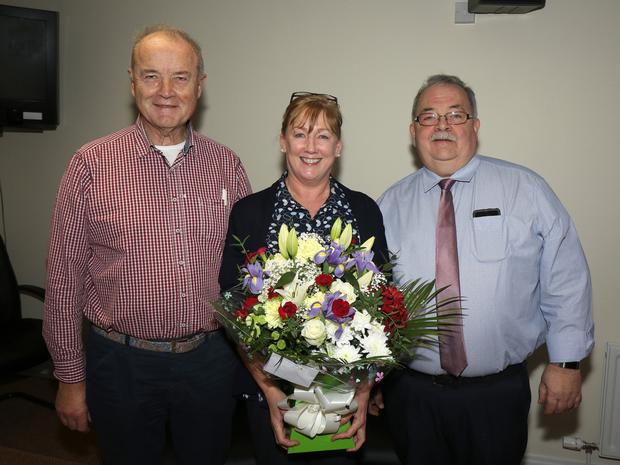 Nicky Cosgrave and acting manager Liam Waters honour Madeleine Doran with a presentation to mark her 40 years of service with Enniscorthy Credit Union