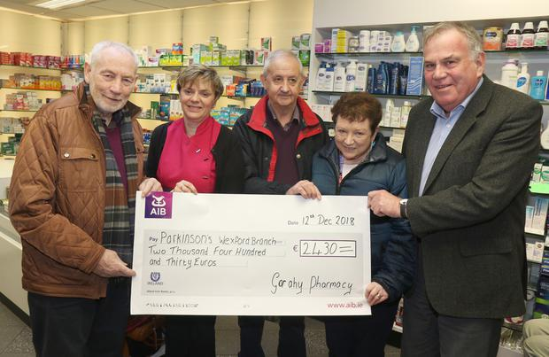 Pat Lacey, Anne Marie Nolan, Matt Murphy, Mary Murphy and David Garahy at a cheque presentation of €2,430 to the Parkinson's Wexford Branch