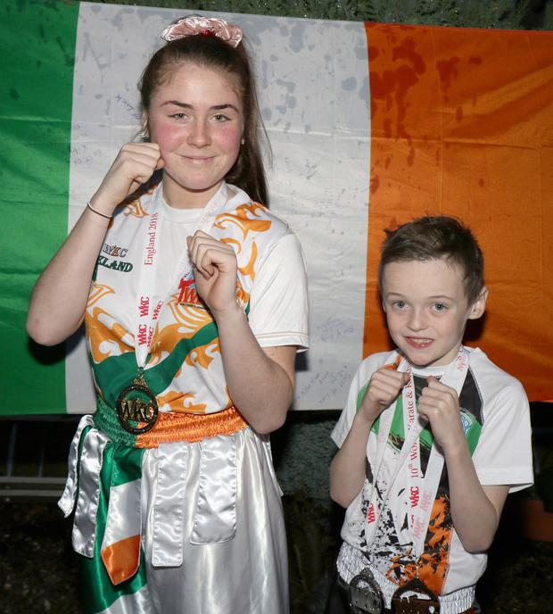 Dragon Kickboxing Club, Enniscorthy members, Robyn Butler from Enniscorthy (won gold at 60kg+) and Adam O'Neill, Askamore (won silver and bronze at 30kg) at the 10th World Karate & Kickboxing Championships in Manchester